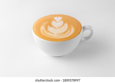 coffee cup with rosetta latte art isolated on a white and gray background closeup. template for drink menu of cafe and restaurant with natural shadow, copy space, side view