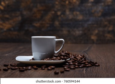 Coffee cup with saucer and coffee beans