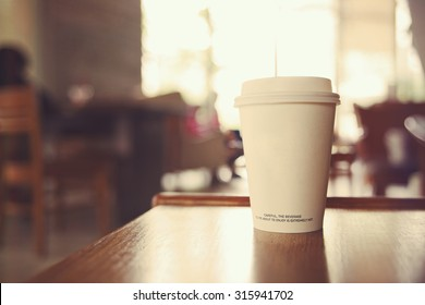 coffee cup in coffee shop with vintage filter