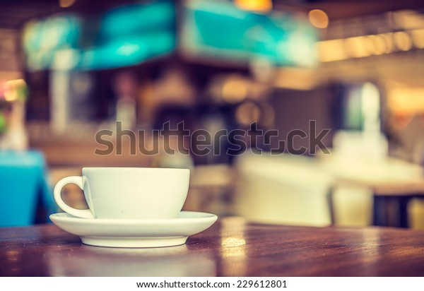 Coffee cup in coffee shop - vintage style effect picture