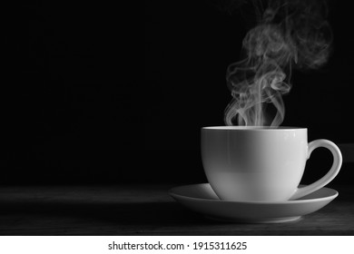coffee cup smoke black background Black and white photo