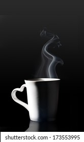 coffee cup with smoke isolated black background