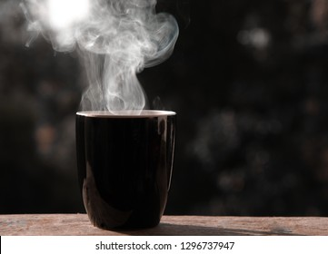 coffee cup with smoke on blur background.