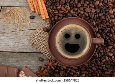 Coffee cup, spices and chocolate on wooden table texture with copy space. View from above