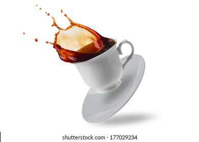 Coffee cup spilling.