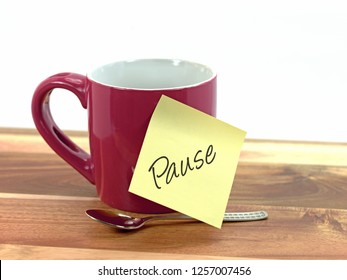 "Coffee cup with sticky note saying break,""Make break"""