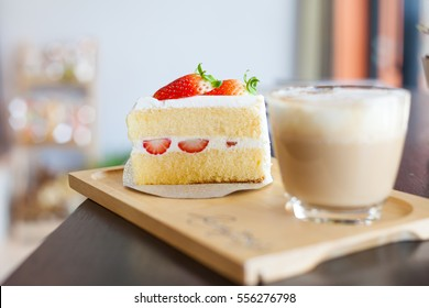 Coffee cup and strawberry cake  in coffee shop