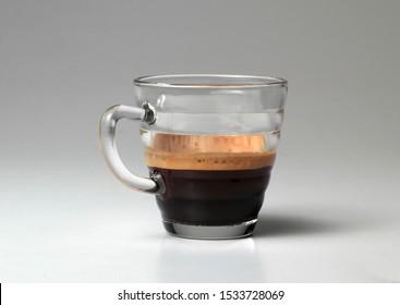 Coffee cup in transparent glass, on a white background