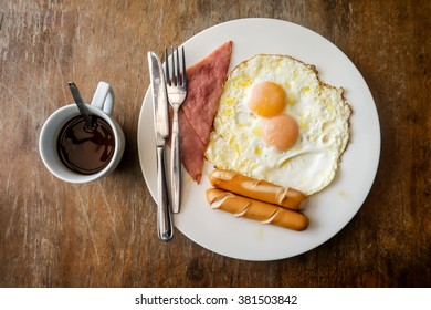 Coffee cup, Two eggs and bacon for healthy breakfast.
