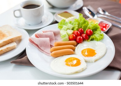 Coffee cup, Two eggs ,sausage and bacon for healthy breakfast.