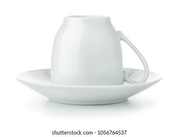 Coffee cup upside down on saucer isolated on white