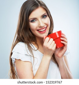 Coffee cup. Young woman on isolated studio background. Beautiful girl portrait. Female model poses.