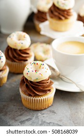 Coffee cupcakes with chocolate frosting and little donuts on top