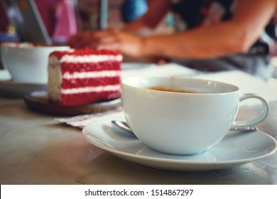 Coffee cups and cakes for sitting with a notebook computer in a coffee shop.