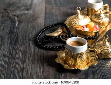 Coffee cups, delight, golden decorations and rosary. Ramadan kareem