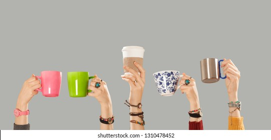 coffee cups  holding hands