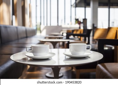 Coffee cups on table blur Restaurant cafe interior background