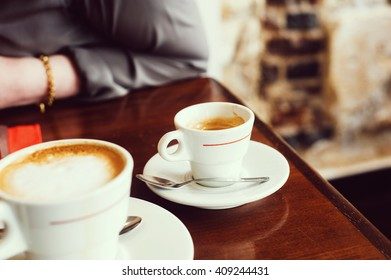 Coffee cups in a Parisian indoors Cafe