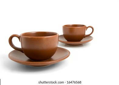 Coffee cups and saucers isolated on white background