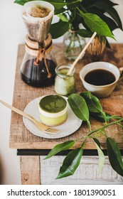 Coffee and dessert setup. Green matcha cheesecake and brewed pour-over coffee in glass flask on rustic wooden kitchen counter, top view. Healthy, vegan, vegetarian, low calorie food concept