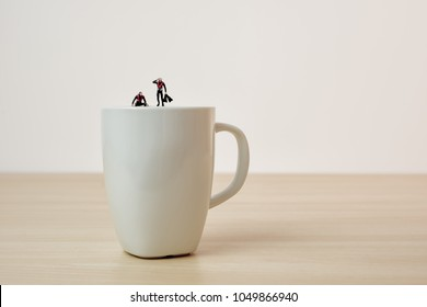 Coffee divers. Conceptual macro photo.