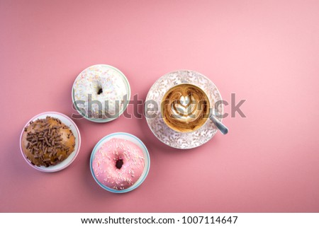 coffee and doughnut latte art cappuccino white wooden desk table work