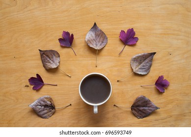 Coffee and dried and red autumn leaves