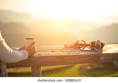 Coffee drink.  Asian girl or Woman life happy and relax  drinking coffee and tea in sun sitting outside in sunshine light enjoying morning, sunrise background. Vintage.  Lifestyle Concept
