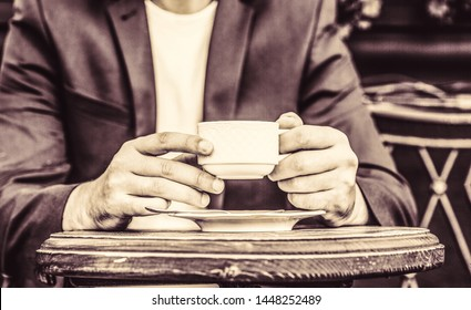 Coffee drink. Coffe time. Hand of man hold coffee or coffe cup at cafe in the morning. Cup of coffee. Close up of a man hands holding a hot coffe cups.