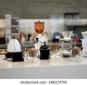 Coffee equipment on white counter