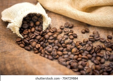 Coffee espresso and coffee cup and beans on table,Tea cup on table,warm cup of coffee on brown background,