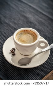 Coffee Espresso. Cup Of Coffee on textile background closeup.