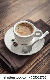Coffee Espresso. Cup Of Coffee on wooden background closeup.