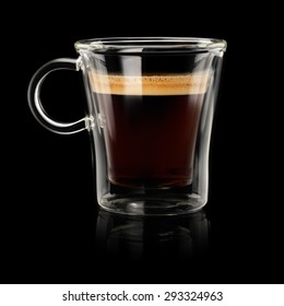 Coffee espresso doppio or lungo in transparent cup on black background