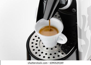 Coffee espresso machine pouring coffee in a white cup, on white background