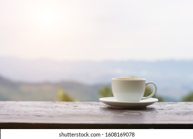 Coffee espresso on wood table nature background in garden,Tea on the table