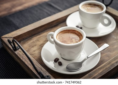Coffee Espresso. Two Cup Of Coffee on wooden background closeup.