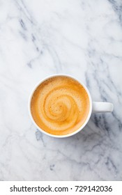 Coffee, espresso in white cup of marble table background. Top view. Copy space.