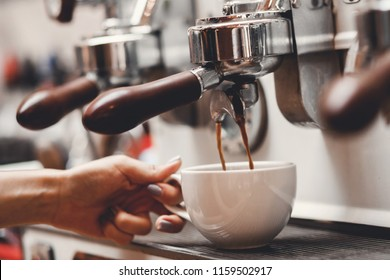Coffee extraction espresso from professional machine and barista with filter
