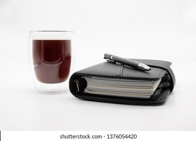 a coffee and a filofax, isolated on white background
