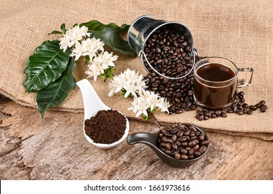 Coffee and flowers on wooden background