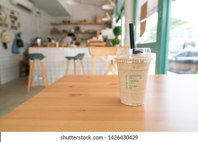 Coffee frappe on wooden table.