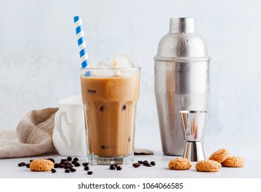 Coffee frappe in a tall glass with ice . and Amaretti cookies
