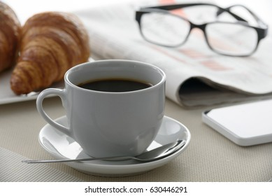 Coffee and french croissants for breakfast at the hotel during the morning press.