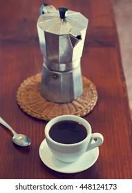 Coffee and geyser coffee maker, retro toned photo