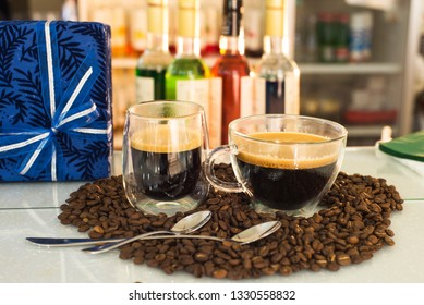 Coffee and a gift on the table are coffee beans against the background of various lecturers.