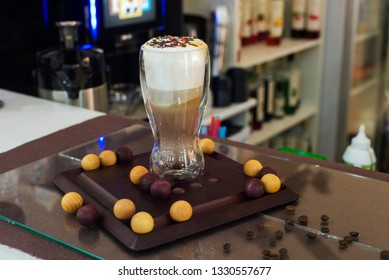 coffee in a glass cup on a barnac rack with a blurred background