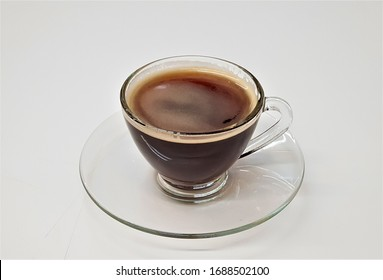 Coffee in a glass cup on a white background
