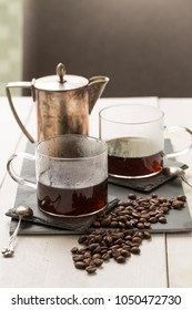 Coffee in glass cups and a tin percolator pot