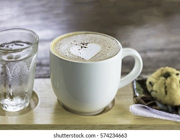 Coffee in a glass on wood background.